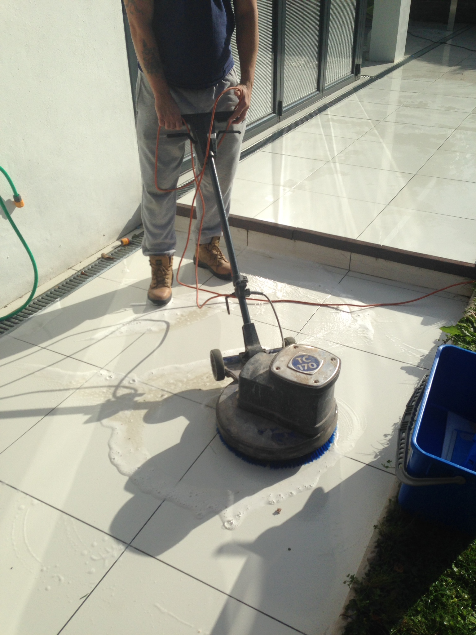 Applying Ant-Slip to a shiny Porcelain Patio